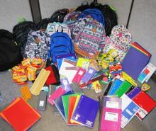 Backpacks and school supplies collected at  Dakota corporate office in Silver Spring, Maryland.